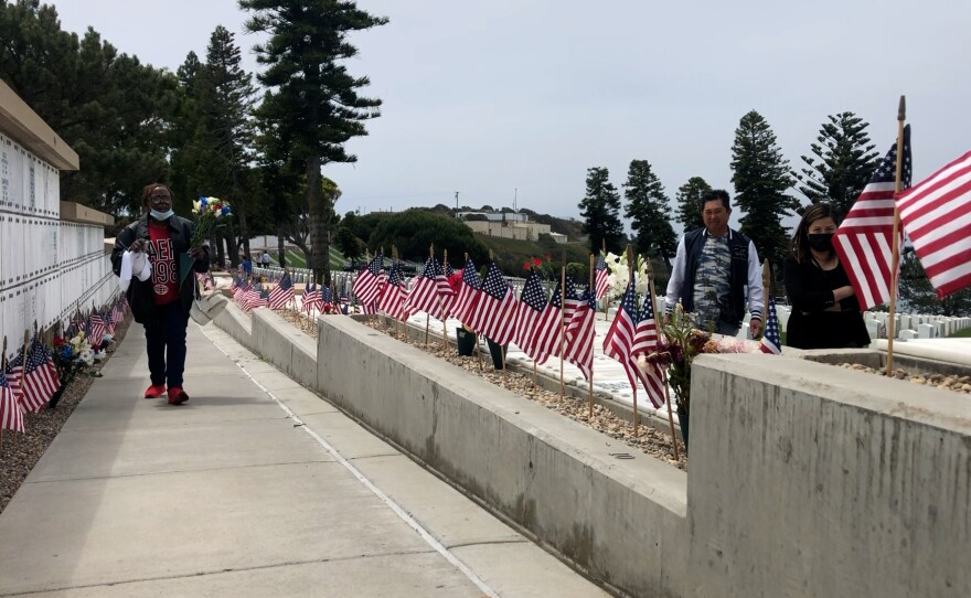 Mourners return to Fort Rosecrans National Cemetery to honor the dead on Memorial Day, May 31, 2021.