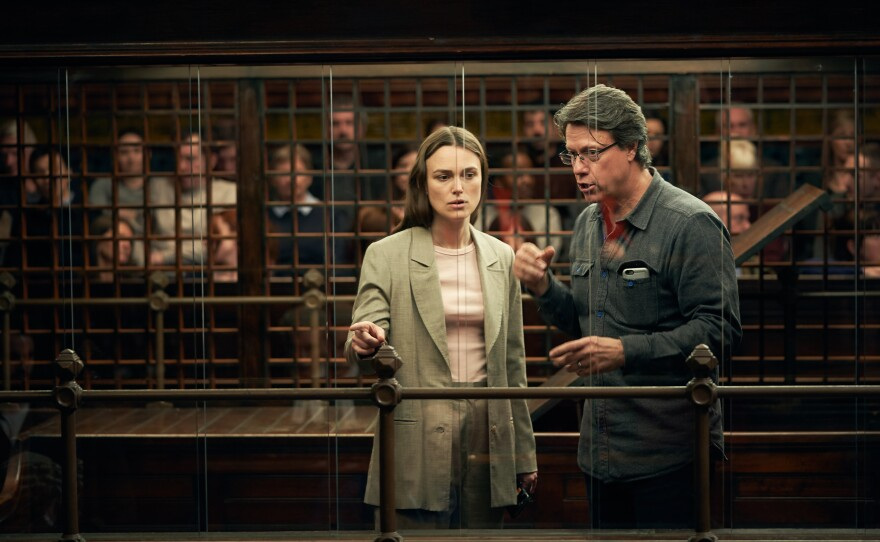 """Actress Keira Knightley and director Gavin Hood on the set of """"Official Secrets."""""""