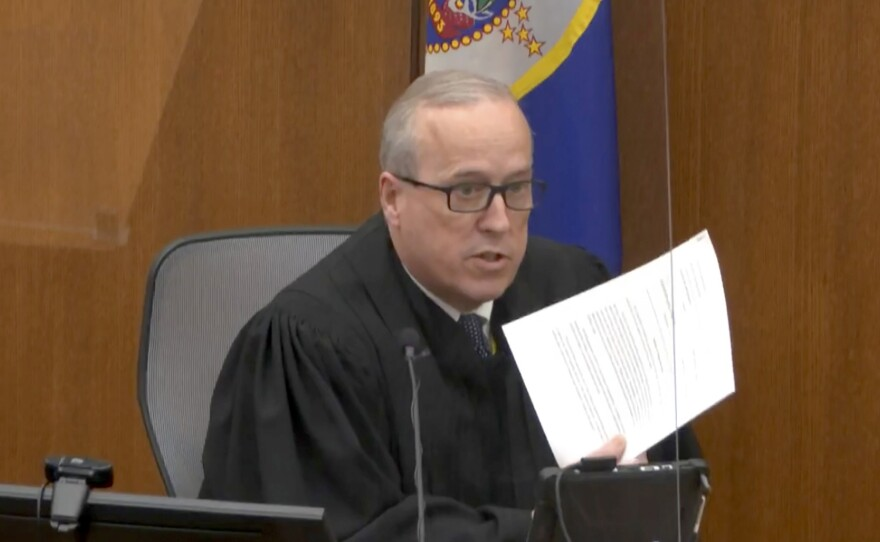 In an image taken from video, Hennepin County Judge Peter Cahill reads instructions to the jury before closing arguments in the trial of former Minneapolis police officer Derek Chauvin, on Monday.