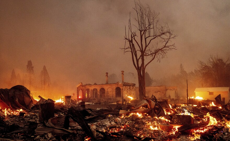 Buildings burn as the Dixie Fire tears through the Greenville community of Plumas County, Calif., on Wednesday, Aug. 4, 2021. The fire leveled multiple historic buildings and dozens of homes in central Greenville.
