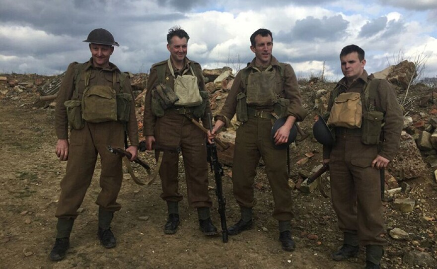James Holland (second from left) and a group of history buffs in accurate kit, recreate a World War II overland march by British Tommies during the Battle of France in 1940.
