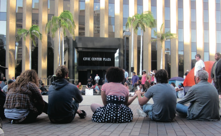 Protesters representing the Occupy San Diego movement demonstrating at the Civic Center Plaza in downtown San Diego.