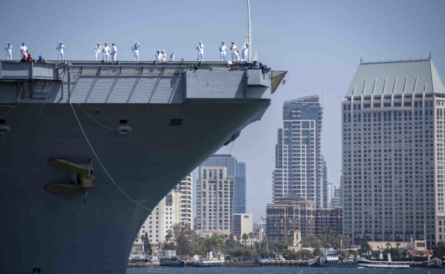 Sailors man the rails aboard Nimitz-class nuclear aircraft carrier USS Carl Vinson as it arrived in San Diego after conducting a home port change from Bremerton, Washington.