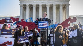 """Former California Gov. Arnold Schwarzenegger speaks at a rally calling for """"Fair Maps"""" at the Supreme Court in Washington, as justices hear arguments about partisan gerrymandering, the practice of political parties crafting congressional districts that unfairly benefit one party over another, in Washington, Tuesday, March 26, 2019."""