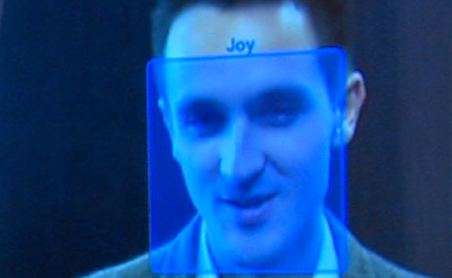 A blue box signifying a joyful expression is superimposed on an image of KPBS reporter David Wagner's face by the Emotient software.