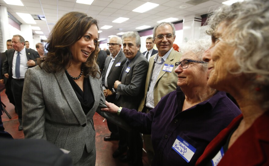 California Attorney General Kamala Harris, left, a candidate for the U.S. Senate, talks with supporters Shelly Bailes, second from right, and Ellen Pontac, right, at a campaign gathering in Sacramento, Jan. 21, 2016.