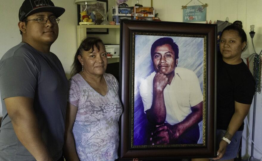 The Maldonado family gathers around a portrait of Angelico Maldonado on Sept. 17, 2020.