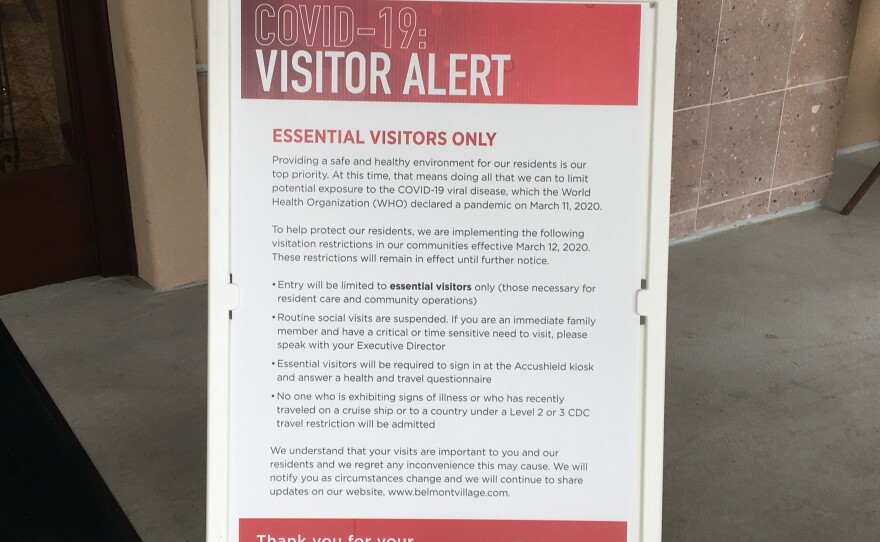 A sign posted outside of Belmont Village Senior Living in Sabre Springs explains the facility's new visitation rules in response to the coronavirus pandemic.
