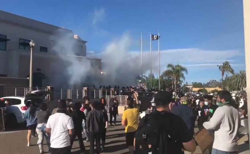 San Diego Sheriff's Department deploying tear gas into the crowd of protesters in front of the La Mesa Police Department Headquarters on May 30, 2020.