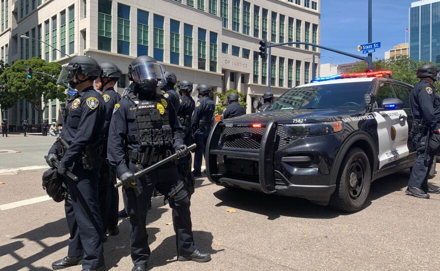 Police officers monitor a protest in downtown San Diego, May 31, 2020.