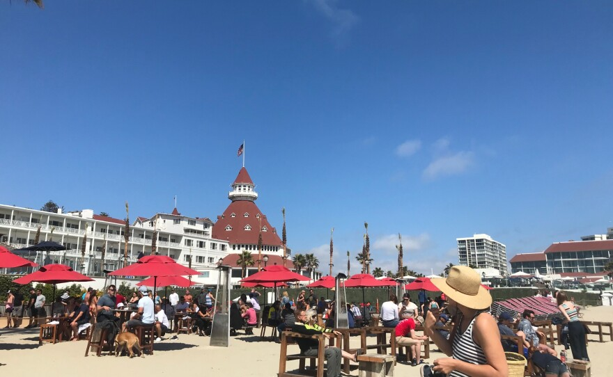 People on the beach in front of Hotel Del Coronado in Coronado, Calif. June 6, 2021.