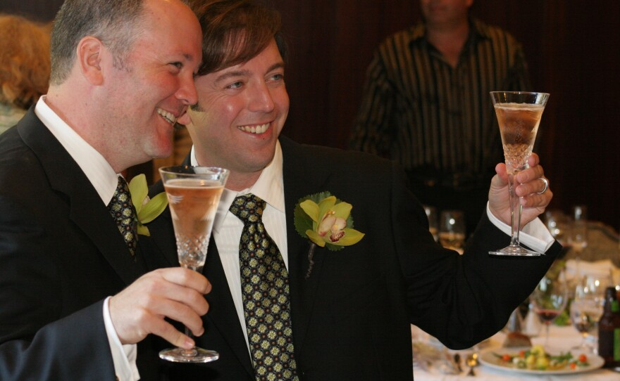 Gleason, and his husband, Marc, toast to their marriage at their wedding in 2008.