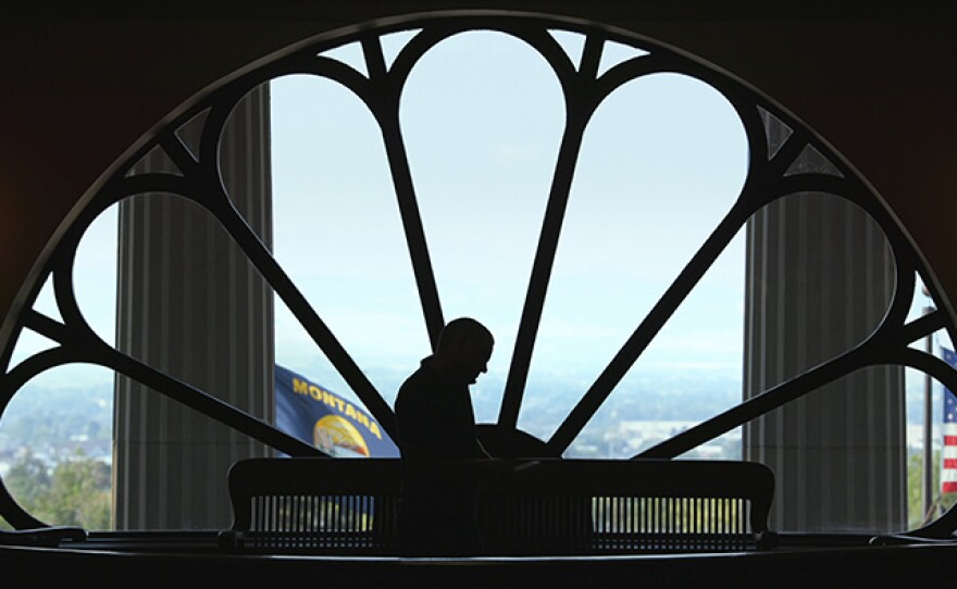 John S. Adams silhouetted in the Montana Capitol building.