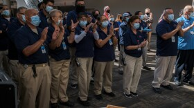 San Diego Convention Center employees applaud during the ceremonial reopening of the San Diego Convention Center in downtown San Diego on July 30, 2021.