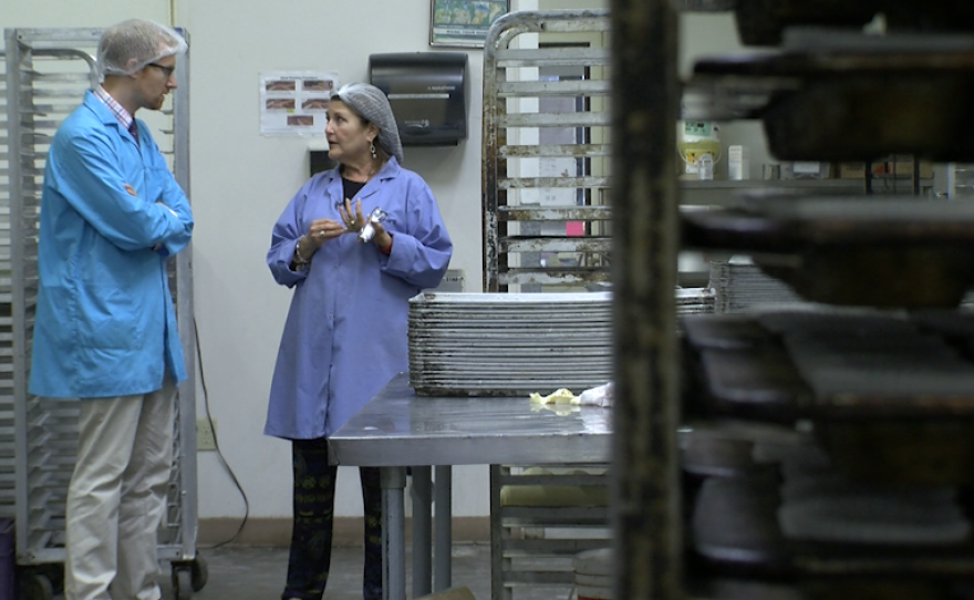 Marcia Sarnow speaks with KPBS reporter Andrew Bowen at her wholesale bakery in Mira Mesa, Sept. 24, 2018.