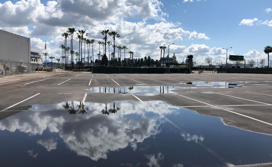 An empty parking lot outside the San Diego International Airport on Mar. 27, 2020.
