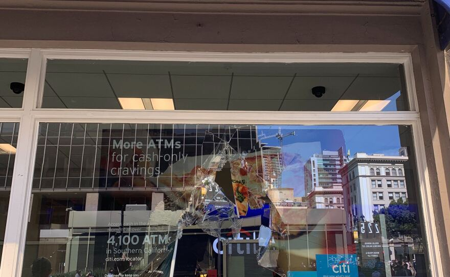 A broken window is pictured at a Citi Bank branch in downtown San Diego after demonstrators threw a chair through it, May 31, 2020.