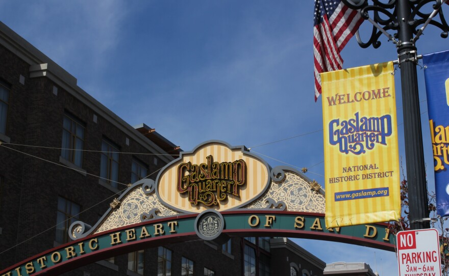 A sign hangs over the entrance to the Gaslamp Quarter on Fifth Avenue in downtown San Diego.