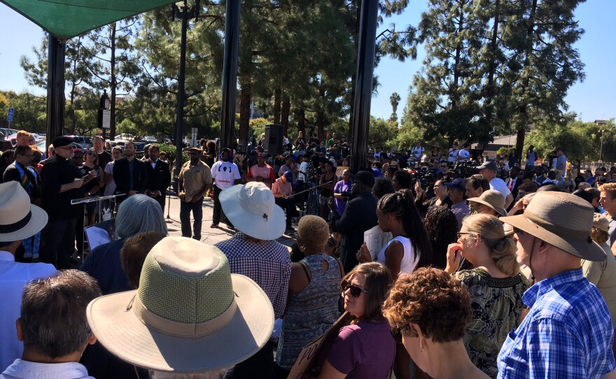 About 200 people gather at Prescott Promenade Park in El Cajon for a prayer service following the police shooting death of Ugandan immigrant Alfred Olango, Oct. 1, 2016.