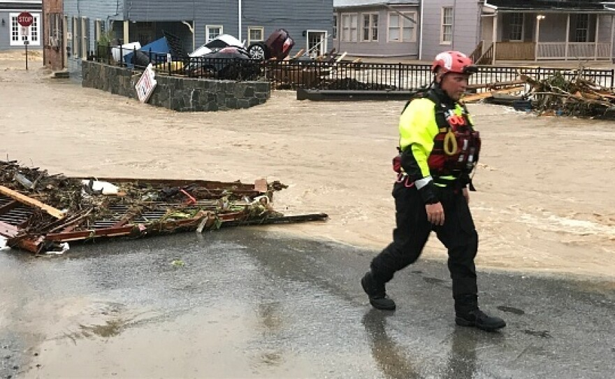 Floods in Ellicott City, Maryland, pushed cars into a pile last May. This year has been a year of record rainfall for cities throughout the mid-Atlantic and Carolinas.