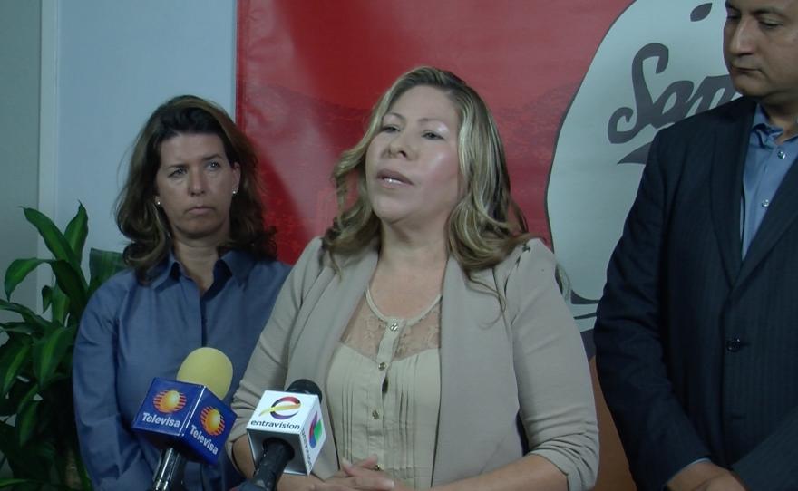 Maria Puga speaks at a press conference, April 14, 2015.