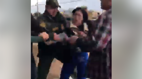 A screen grab of a Facebook video shows Perla Morales-Luna allegedly being arrested by U.S. Customs and Border Protection agents in National City, March 8, 2018.