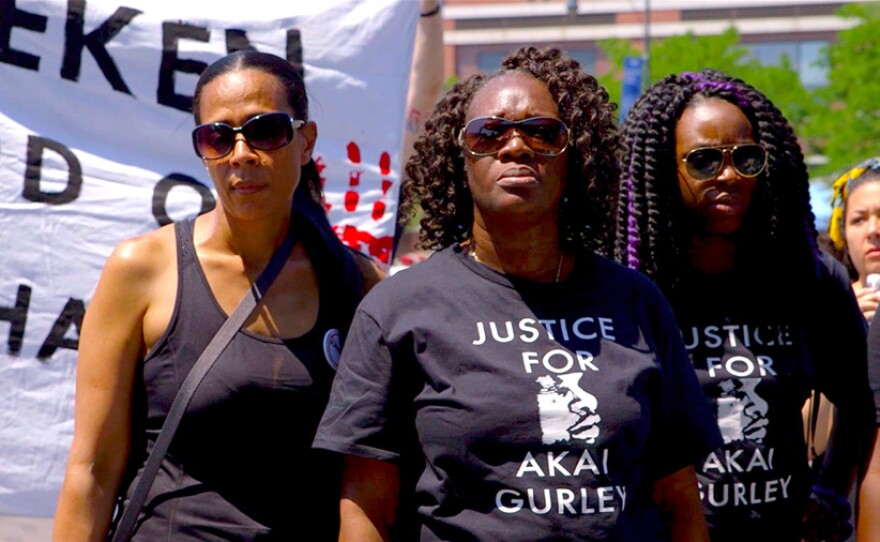 Akai Gurley's aunt, Hertencia Petersen (center), attends a rally outside of Barclay's Center in Brooklyn wearing a Justice for Akai T-shirt. This protest ultimately marched by Brooklyn D.A. Ken Thompson's home.