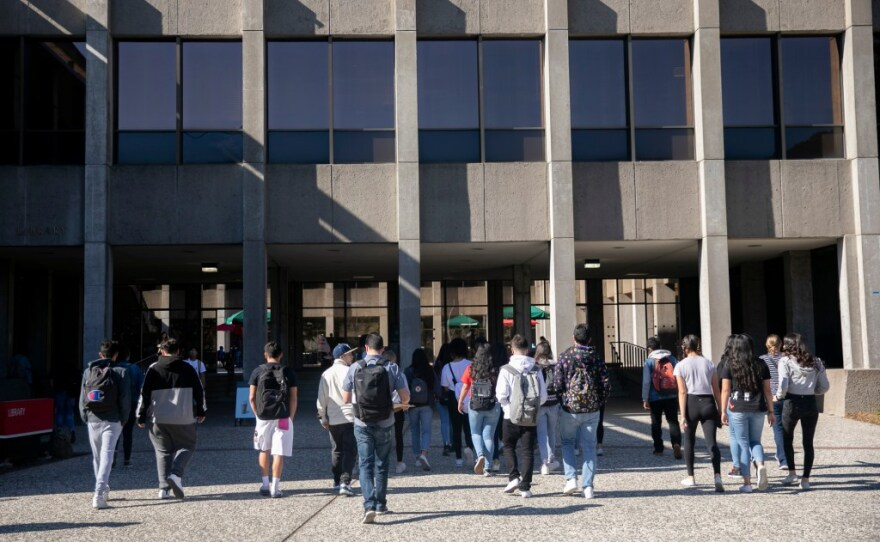 Students walk across campus at California State University East Bay on February 25, 2020. CSU is requiring that all students be vaccinated by Sept. 30.