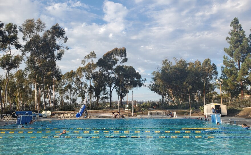 People swim at the Tierrasanta Aquatic Center, which has recreational swim hours until 7:30 p.m. on Fridays, Sept. 17, 2021.
