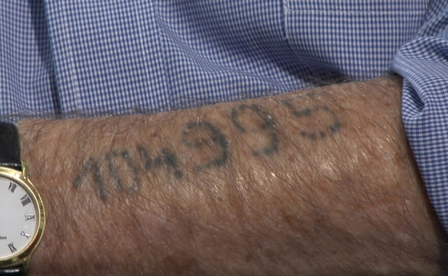 The arm of Ernest Michel, a survivor of the Auschwitz concentration camp in Poland.