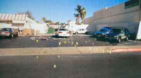 A photo of evidence from the James Carter case showing the parking lot at Dr. J's Liquor.
