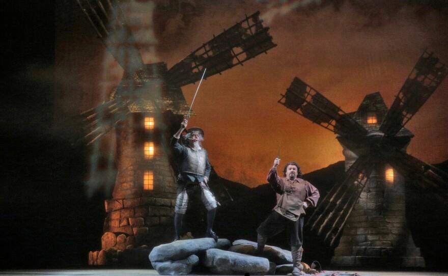 "Tilting at windmills with Bass Ferruccio Furlanetto as Don Quixote and bass baritone Eduardo Chama as Sancho Panza in San Diego Opera's ""Don Quixote."""