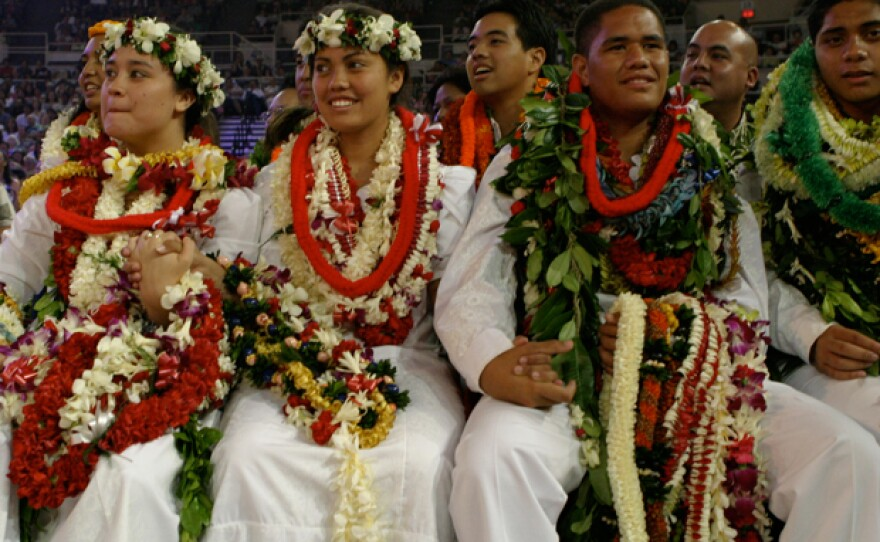 A group of juniors. Every year in Hawai'i, 2,000 high school students compete in the Kamehameha Schools Song Contest, in which young leaders direct their peers in singing Hawaiian music in four-part harmony.