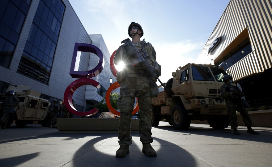 Members of the California National Guard stand watch at the Downtown Commons area of Sacramento, Calif. June 1, 2020.