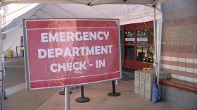 """""""Emergency department check-in"""" sign posted outside of the Rady Children's Hospital emergency room, June 8, 2021."""