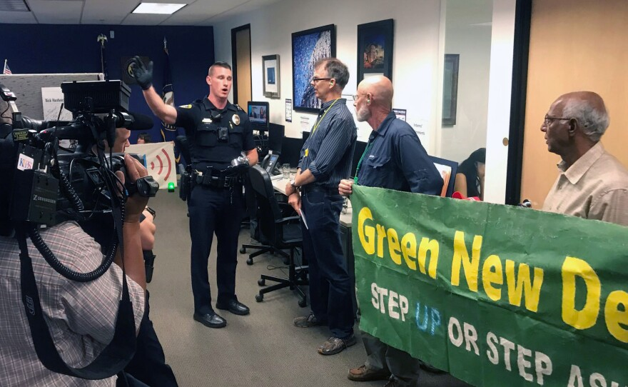 A San Diego police officer asking the protesters to vacate Rep. Scott Peters office on Sept. 26, 2019.