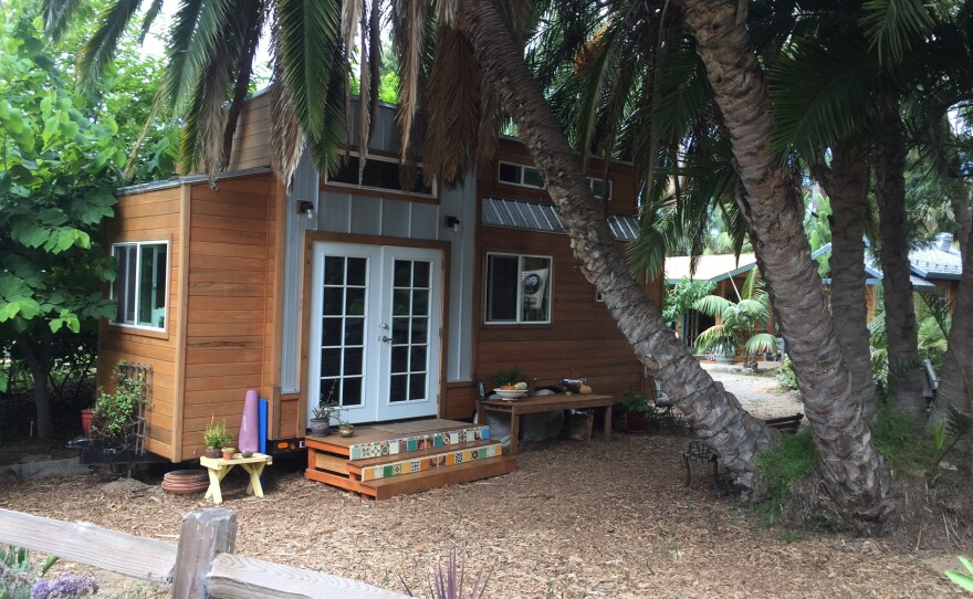 Ashley Mazanec's tiny home is shaded by a large palm tree, Sept. 13, 2017.
