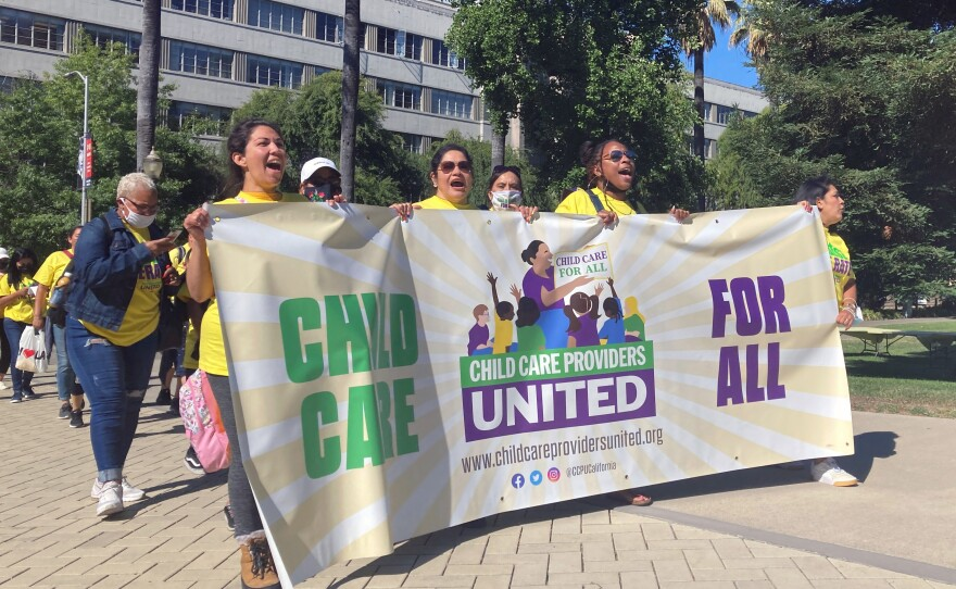 Childcare providers, including from left, Justine Flores, Sylvia Hernandez, Rasiene Reece and Zoila Toma, right, rallied at the at the Capitol, in Sacramento, Calif., June 24, 2021.