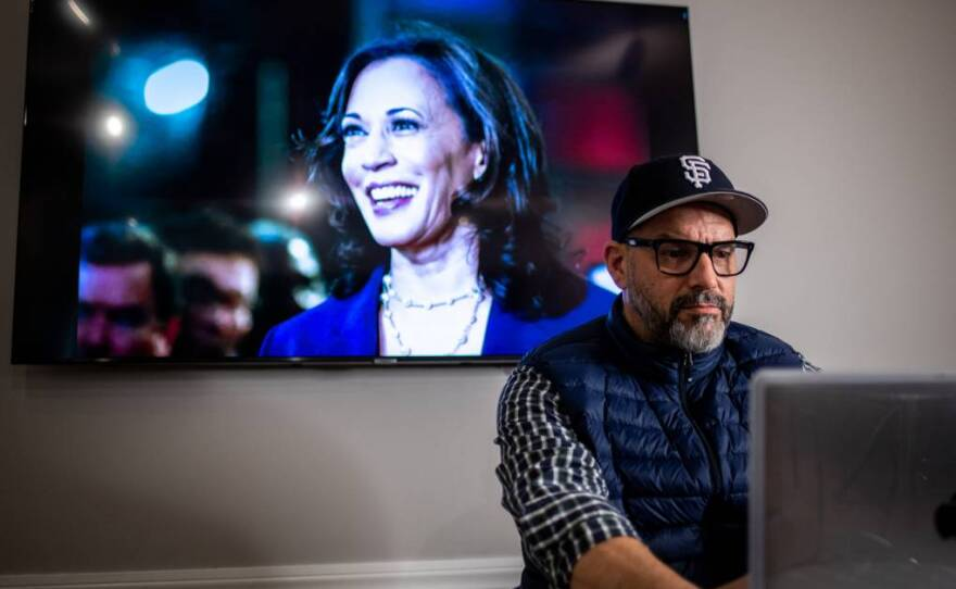 Billy Lemon works at the Castro Country Club in San Francisco on Jan. 14, 2021, with Vice President-elect Kamala Harris on a television screen in the background.