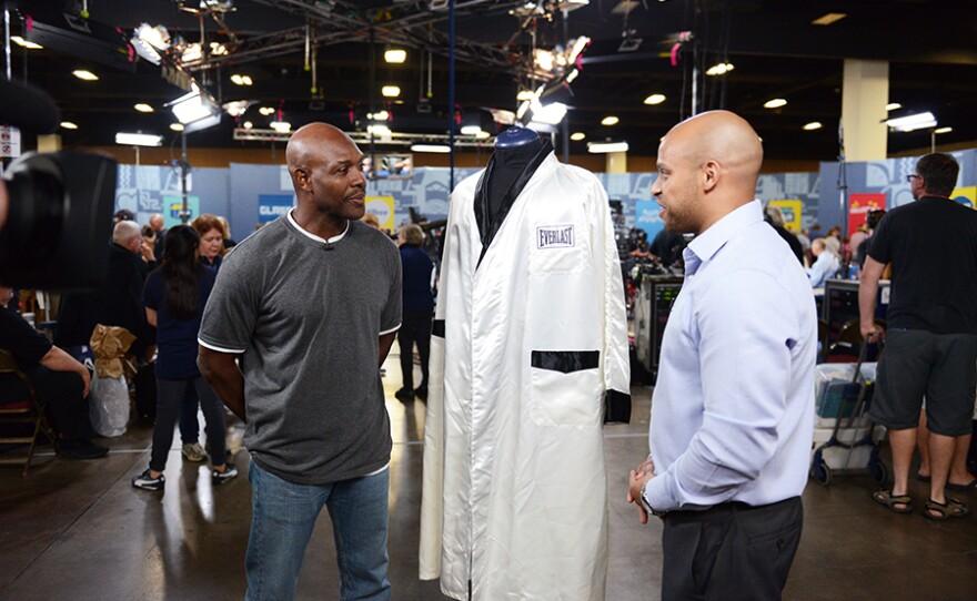 Jasmani Francis (right) appraises a Muhammad Ali-signed robe, ca. 2000
