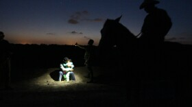An agent on horseback is silhouetted at the scene near La Grulla, Texas in this undated photo.