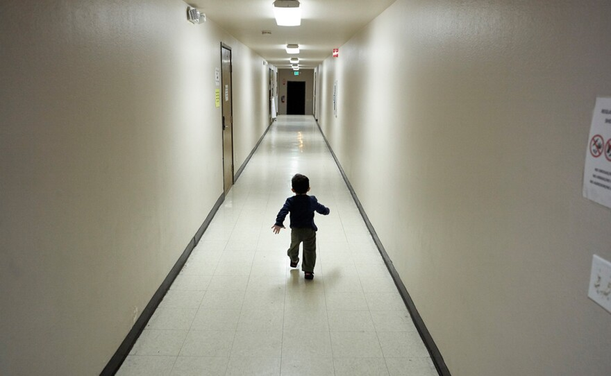 An asylum-seeking boy from Central America runs down a hallway after arriving from an immigration detention center to a shelter in San Diego, Dec. 11, 2018.