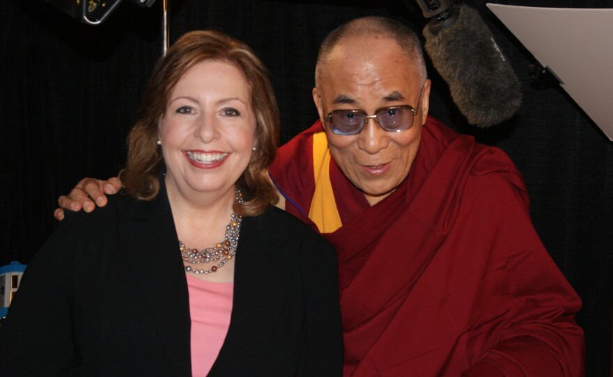 KPBS Midday Edition host Maureen Cavanaugh poses with the Dalai Lama during a KPBS exclusive interview at San Diego State University on April 19, 2012.