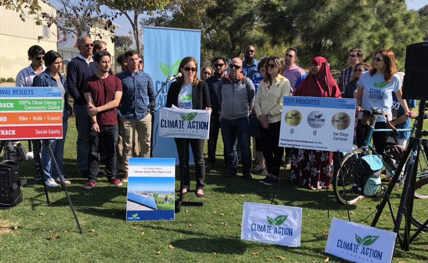 """Climate Action Campaign supporters gathered at Park De La Cruz Tuesday to discuss their 2017 """"Climate Action Report Card"""" for San Diego County."""