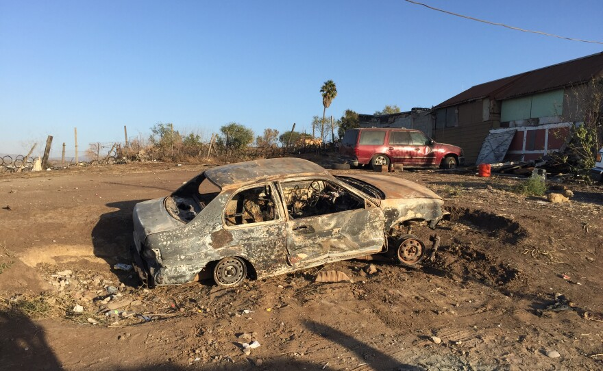 A burned-out car in the Morelos neighborhood of Rosarito, Mexico on Oct. 29, 2019.