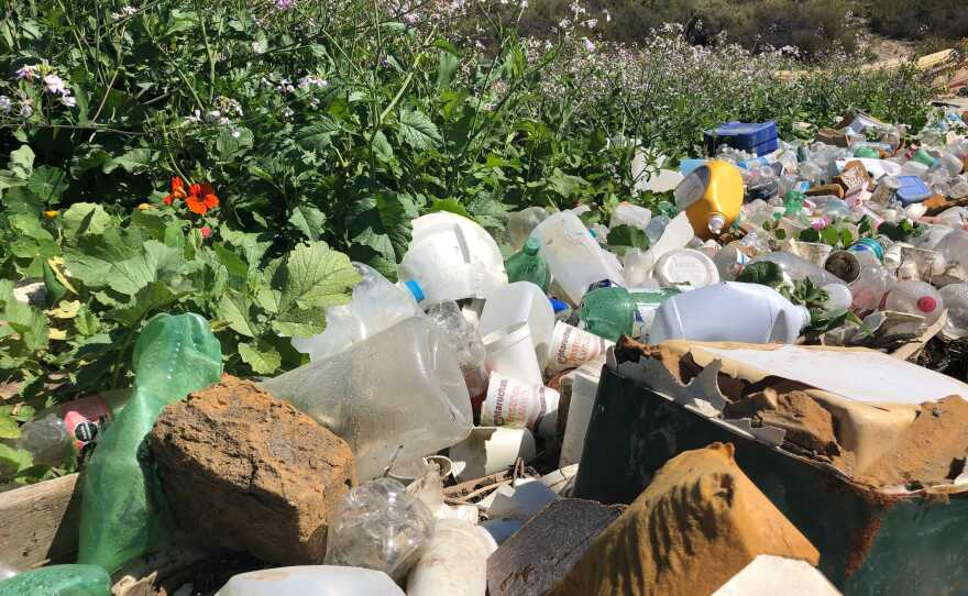 Plastics pile up at a trash boom in goat canyon north of the U.S. Mexico border on Apr. 19, 2021.