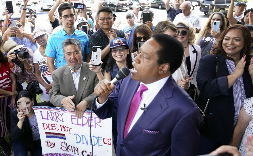 In this July 13, 2021, file photo, conservative radio talk show host Larry Elder speaks to supporters during a campaign stop in Norwalk, Calif.