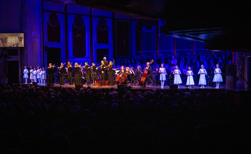"""The names of the victims are read as children from the Pittsburgh Ballet Theatre enter the stage holding candles to represent each victim. The Pittsburgh Symphony Orchestra then performs """"Eli Eli"""" by Israeli composer David Zehavi as the children remain onstage."""