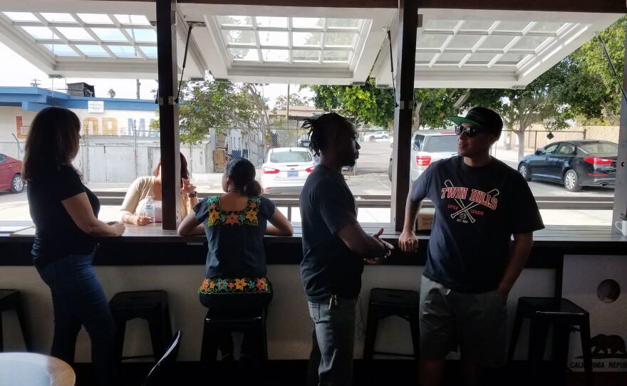 Tommy Walker and other owners of Project Reo Collective gather at their coffee shop, Sept. 30, 2018.