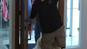 Former Marine Sgt. Nick Kimmel opens the door to his new home in Fallbrook, Jan. 5, 2016.